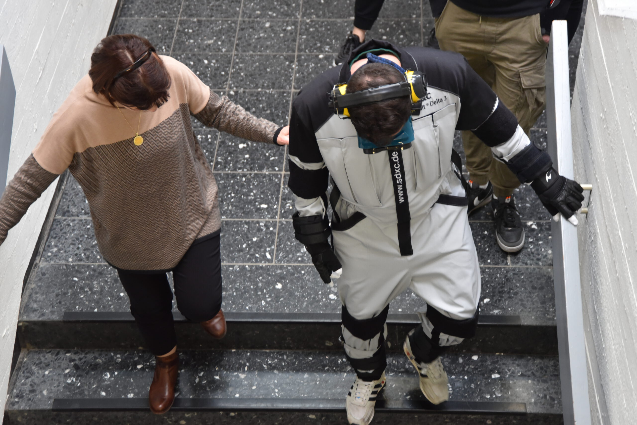 Old age problems experienced on the stairs by simulation with the SD&C Senior Suit Delta 3 old age simulation suit